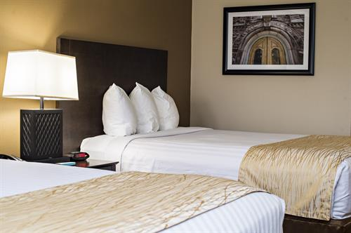 Relax in a room with 2 double beds that include a microwave and refrigerator.