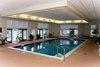 Indoor heated pool, whirlpool, and sun deck overlooking the golf course