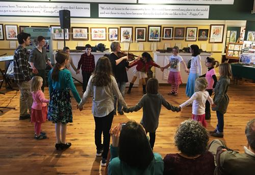 Children learning traditional dances at TAUNY's 2017 Sugaring Off Party