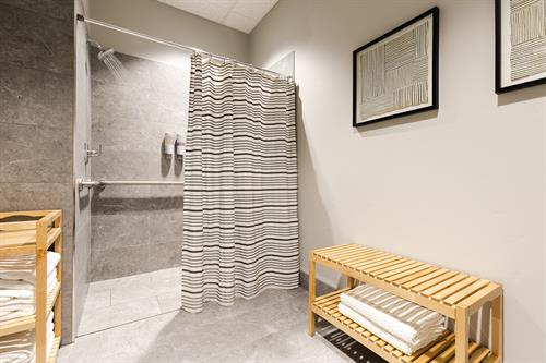 Private shower rooms stocked with towels