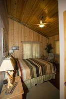 "Homestead ""Four Seasons"" 2 BR Suite master bedroom has King bed and oversize tile shower with bench seat."
