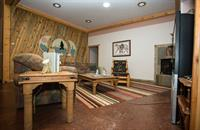 """Homestead """"Four Seasons"""" Suite living room has couch/futon to add extra bed if needed."""