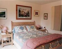 B&B second Queen bedroom. Home is decorated with western and wildlife art - paintings, sculptures and photography.