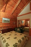 Maluhia cabin - one of two Queen bedrooms. Cabin is decorated with Polynesian and wildlife art; a peaceful Zen vibe.