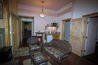 """Homestead """"Pond Room"""" has Queen bed, seating area and kitchenette, electric fireplace as backup heat. Opens to back deck with hot tub and propane BBQ."""