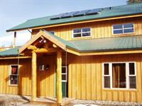 Homestead Lodge is great for groups of up to 15. 5BR 5BA 4500 sq ft. Rooms w/ private baths & kitchenette or full kitchen. Hot tub, BBQ. On rural acreage with river access.
