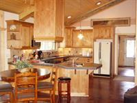 "Homestead ""Four Seasons"" Suite very open kitchen-dining-living room makes great social spaces."