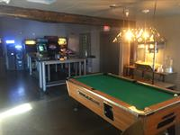 ATLAS Cider Co.'s pool table & arcade are available to play while you enjoy our Ciders