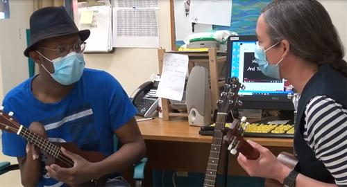 Riverside Client and Staff practicing music
