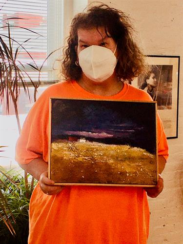 Riverside Client showing her painting that sold at the Riverside auction