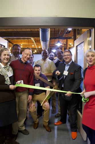 Official ribbon cutting of our new office space within Mill180