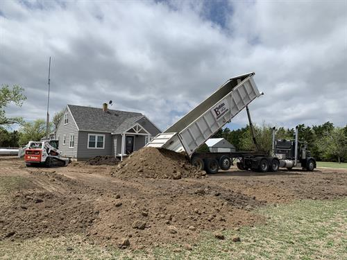 Hauling dirt in for help with water issues around the house