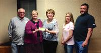 Donita Wolf accepts donation from the Bikers of Central Kansas from the proceeds of their Chili Challenge fund raiser.