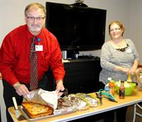 Larry Schumacher, Chaplain and Cathy Soeken, social worker are preparing dinner for the Grief Support Group