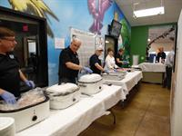 Zoo Society Board of Directors serving dinner at the World Binturong Day celebration.