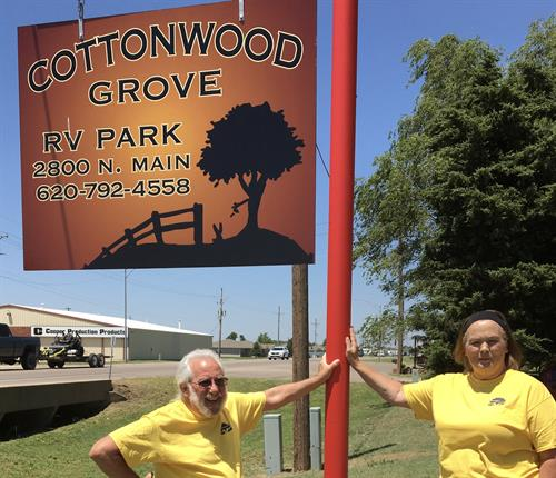 Our On-Site Manager Gregg Chartier and Owner Renee Albrecht by our new RV Park Sign