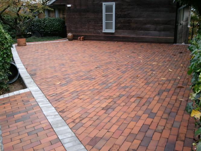 The top deck of brick pavers in a sand bed for the parking area
