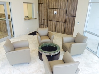 Built wall & soft-seating gathering area.