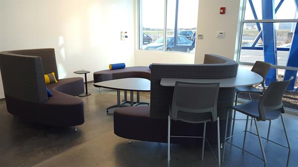 One of our breakout sitting areas, with a dry-erase wall for brainstorming or doodling.
