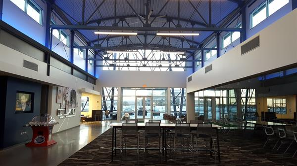 The heart of FMA headquarters is the Fabricators Concourse; and open air lobby with several seating areas, work tables, and fun diversions for staff and visitors like ping-pong and bubble hockey.