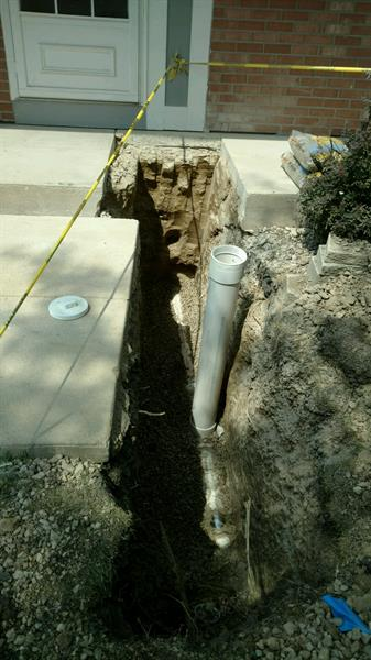 Main sewer repair and installation of new outside cleanout