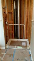Installation of new shower base and rough-in plumbing for new bathroom