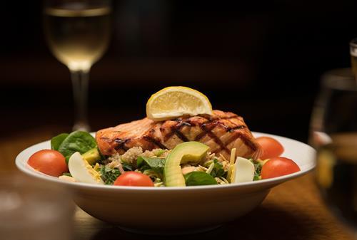 Atlantic Salmon dinner and a glass of Barrel fresh premium wine on tap