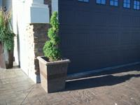 Our Stone Works planters are solid concrete. Suitable for small trees.