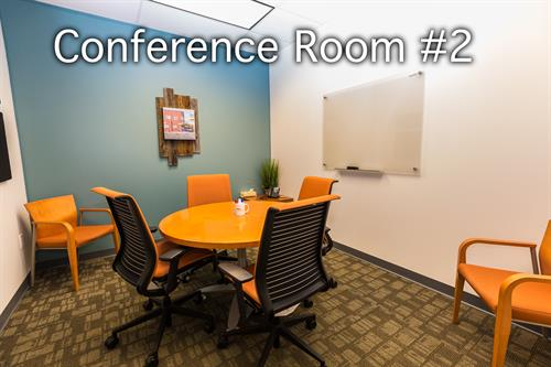 This small conference room is perfect for you to conduct your business in a professional setting.