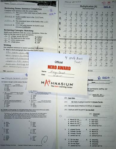 Four 100% math tests from school!