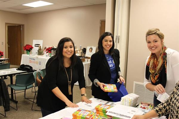 Women United prepare newborn packets to help new moms get off to a good start.