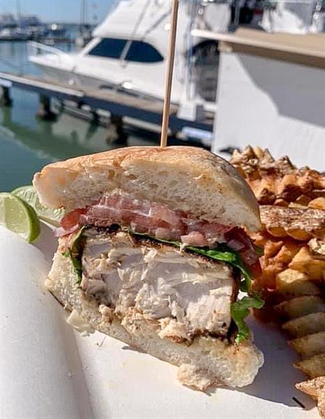Blackened Mahi Mahi Sandwich 1/2 pound fillet served with fries and slaw