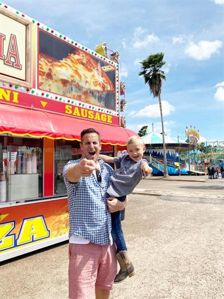 Noah Cappe, host of Carnival Eats at Charro Days with our son, Grant (February 2020)