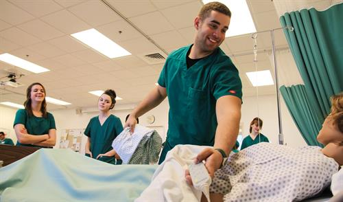 Durham Tech students practice nursing techniques at the Orange County Campus.