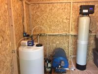 Our handiwork, a professionally installed iron filter and chlorinator.