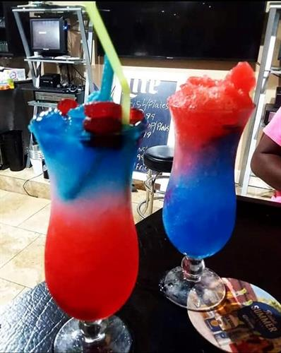 Shaved Ice Snows cones served in a glass.