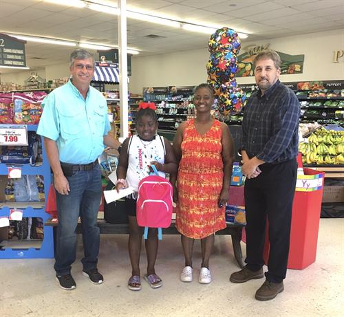 Winner of Back to School $25.00 gift certificate and backpacks filled with school supplies