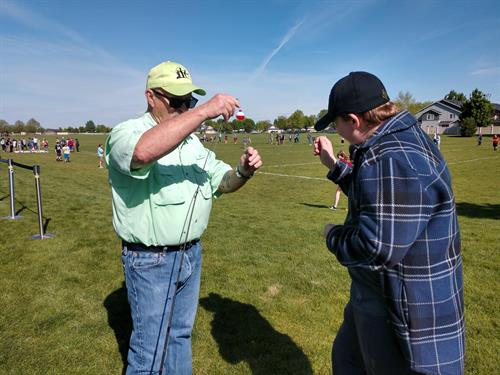 Idea is to catch fish, not your finger.  Ron(KFCI Board & Volunteer) teaching student how to secure your line.