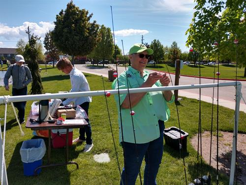 Cindy Clancy, (KFCI Volunteer & Board), getting ready to share fishing with 250 Sawtooth Middle School Students.