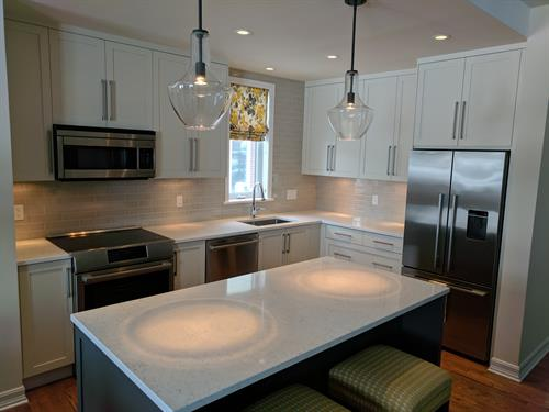 Kitchen - New cabinets, quartz counters and back-splash, lighting
