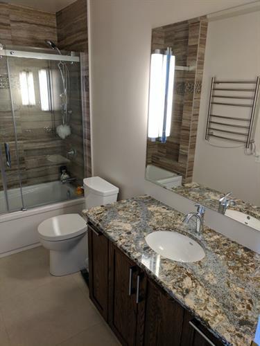 Bathroom - New bathtub, vanity, quartz counters, wall and floor tile
