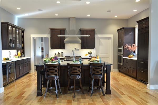 A transitional style kitchen in a rich dark finish