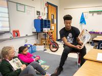 Royals basketball players bring smiles to Waterman readers