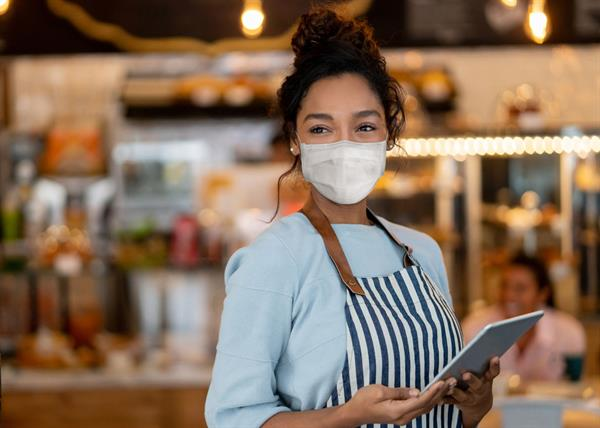 Gallery Image Beautiful-waitress-working-at-a-restaurant-wearing-a-facemask-1225861935_7071x5054.jpg