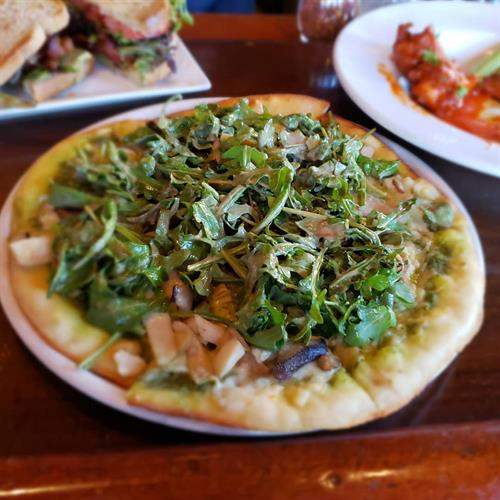 Shrooms Pie topped with arugula