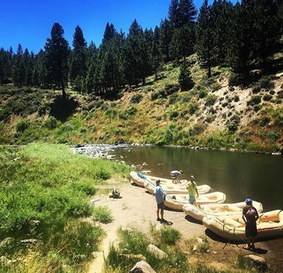 Guides preparing the boats at put-in for Truckee River Rafting.