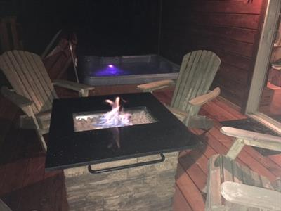 Gas fire pit is built-in, so you just push a button to turn it on