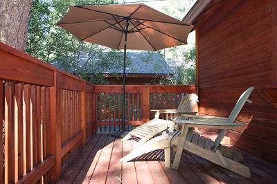 Front porch under the pine trees. Deck chairs and umbrella in the spring, summer & fall.