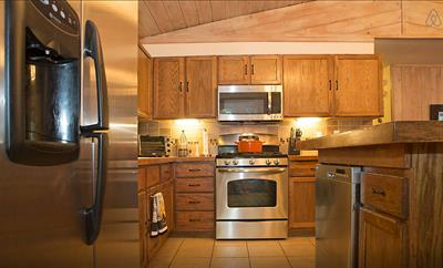 Chefs kitchen with gas stove and all new stainless appliances + microwave oven, dishwasher, double-door fridge with ice maker, toaster, coffee maker, kettle and loads of gadgets and cooking tools, pots, pans ++ in the cupboards