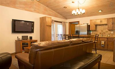 You can relax and enjoy the great room with your family and friends. Chill out on the leather sofa and deep pub chair while watching the plasma TV after a day in the snow